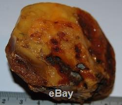 Natural Baltic Amber Stone. Egg Yolk/Brindled/Cognac color. 77,5 g (a374)