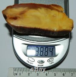 Natural Baltic Amber Stone. Egg Yolk/Brindled color. 38,8 g (a1163)