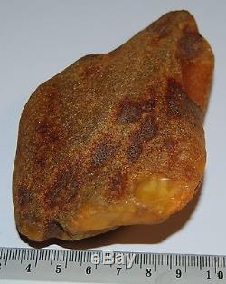 Natural Baltic Amber Stone. Egg Yolk/Brindled color. 99 g (a364)
