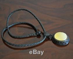 Natural butterscotch baltic amber pendant on a leather cord